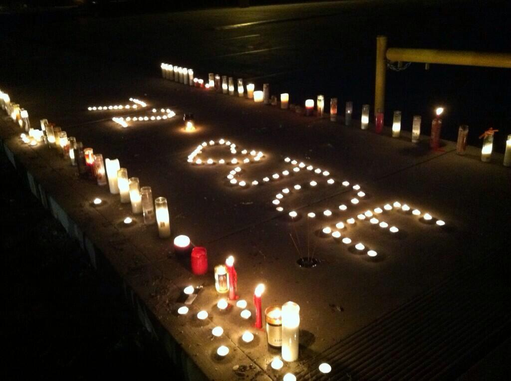 Students gather around the student parking lot on Saturday, Jan. 18, for a candle vigil.