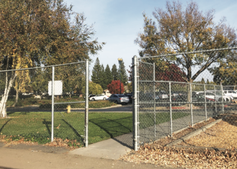 Stranger Danger: One of two gates (left) connecting Bear Creek to Julia Morgan is left wide open and unsupervised during school hours, permitting Bear Creek students to leave campus and outsiders to enter campus. Despite the sign posted on each gate at Bear Creek reminding students to not open the gate for anyone (right), some students still open the gate for teachers and fellow students.