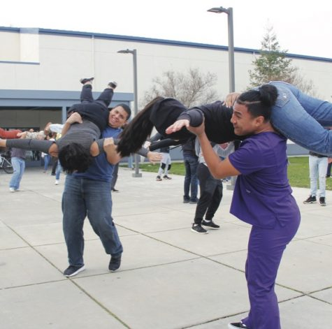 "Floating Angels: Swing Club seniors Joshua Rivera and Angelo Yuw (left to right) lift their partners in a move called ""Angel Variation"" as they prepare for International Rally."
