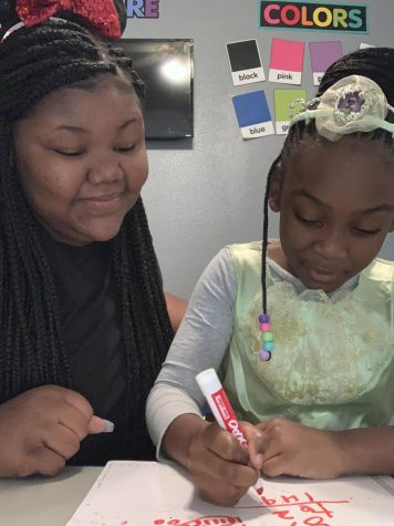 A Helping Hand: Junior Takeyia Thompson sometimes has to leave her own classes to assist her second grade sister, Maliyah, and must email her teachers after class to explain or ask questions.